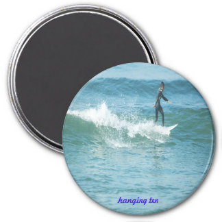 Hanging ten, on a magnet