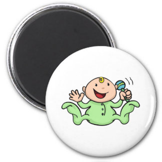 Happy cute baby playing with rattle refrigerator magnet