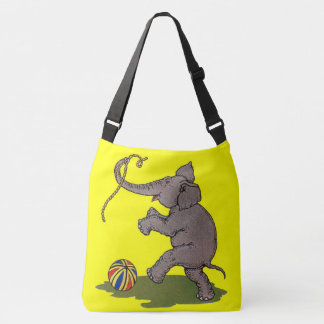 happy elephant playing with rope and ball crossbody bag