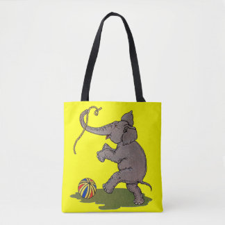 happy elephant playing with rope and ball tote bag