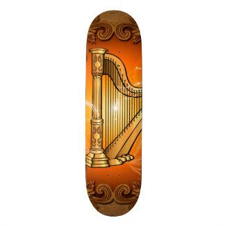 Harp in gold with elegant damasks skate board decks