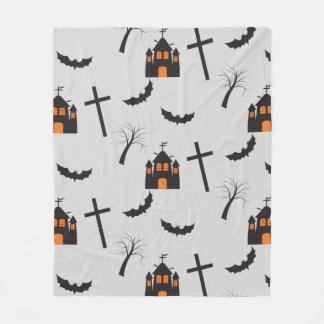 Haunted house, dead tree, bat, cross pattern fleece blanket