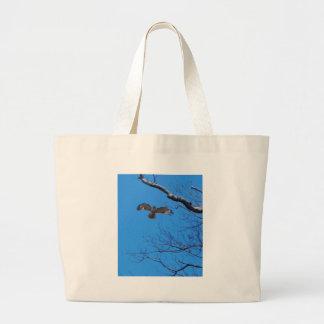 Hawk in flight large tote bag