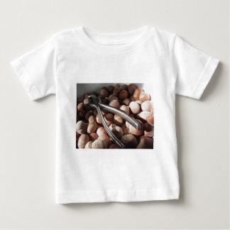 Hazelnuts in bowl with metal nutcracker t shirts