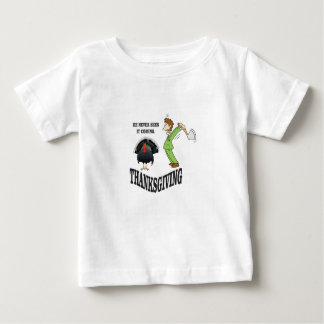 he never sees it coming baby T-Shirt