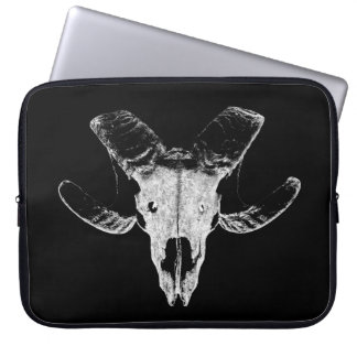 Head of the sheep on black laptop bag
