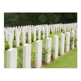 Headstones in a war cemetery postcard