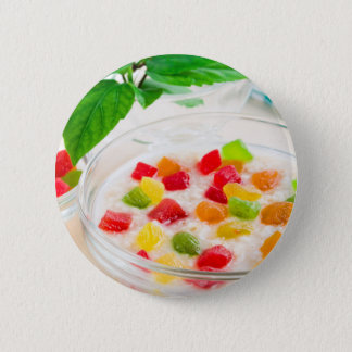 Healthy oatmeal close-up with candied fruit 6 cm round badge