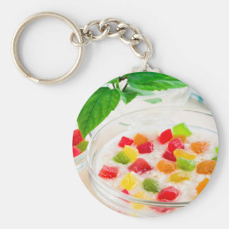 Healthy oatmeal close-up with candied fruit key ring