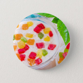Healthy oatmeal close-up with colorful candied 6 cm round badge