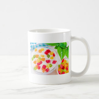 Healthy oatmeal close-up with colorful candied coffee mug