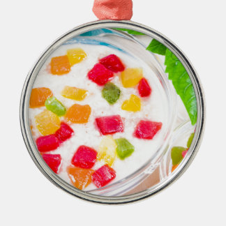 Healthy oatmeal close-up with colorful candied metal ornament