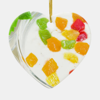 Healthy oatmeal close-up with colorful fruits ceramic heart decoration