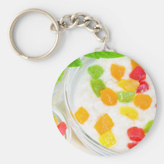 Healthy oatmeal close-up with colorful fruits key ring