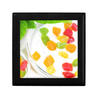 Healthy oatmeal close-up with colorful fruits small square gift box
