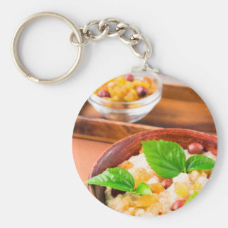 Healthy oatmeal with berries, raisins and herbs key ring