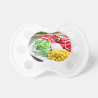 Healthy vegetarian dish of fresh vegetables baby pacifier