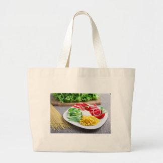 Healthy vegetarian dish of fresh vegetables large tote bag