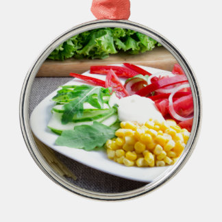 Healthy vegetarian dish of fresh vegetables metal ornament