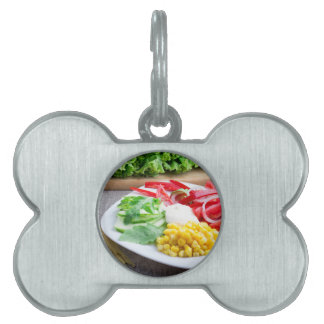 Healthy vegetarian dish of fresh vegetables pet name tag