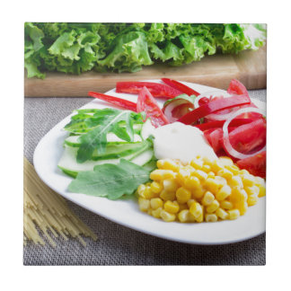 Healthy vegetarian dish of fresh vegetables small square tile