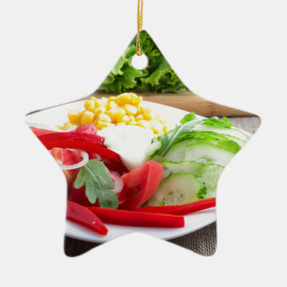 Healthy vegetarian dish on a gray textured fabric ceramic ornament