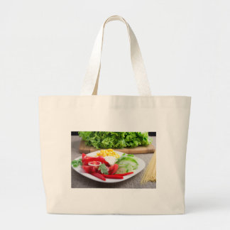 Healthy vegetarian dish on a gray textured fabric large tote bag