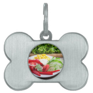 Healthy vegetarian dish on a gray textured fabric pet name tag
