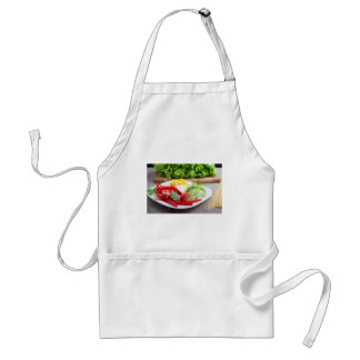 Healthy vegetarian dish on a gray textured fabric standard apron