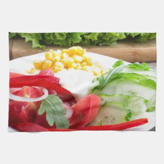 Healthy vegetarian dish on a gray textured fabric tea towel