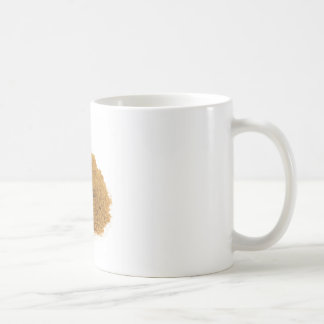 Heap of cinnamon powder on white background coffee mug