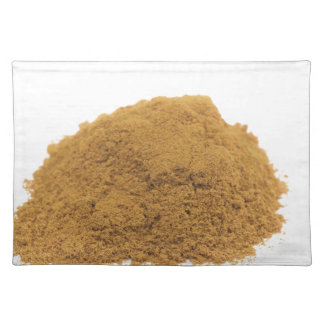 Heap of cinnamon powder on white background placemat