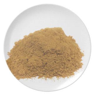 Heap of cinnamon powder on white background plate