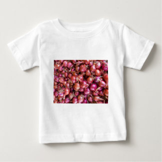 Heap of red onions on market baby T-Shirt