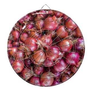 Heap of red onions on market dartboard