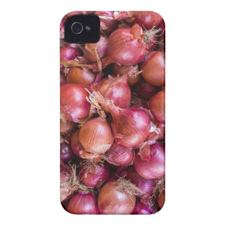 Heap of red onions on market iPhone 4 cases