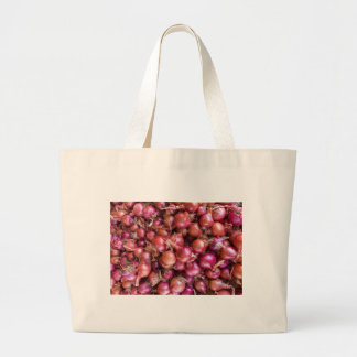Heap of red onions on market large tote bag