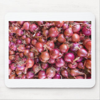 Heap of red onions on market mouse pad