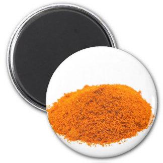 Heap of spice cayenne pepper powder on white 6 cm round magnet