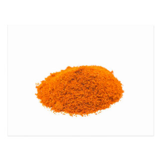Heap of spice cayenne pepper powder on white postcard