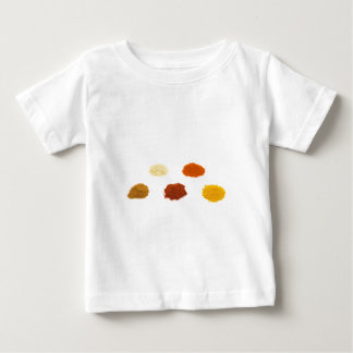 Heaps of several seasoning spices on white baby T-Shirt