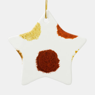 Heaps of various seasoning spices on white ceramic star decoration