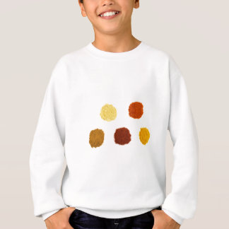 Heaps of various seasoning spices on white sweatshirt