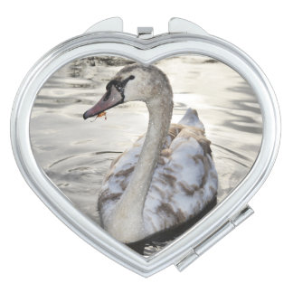 Heart compact mirror featuring Swan on the lake