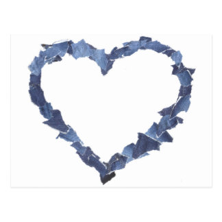 Heart frame made of denim jeans pieces. postcard