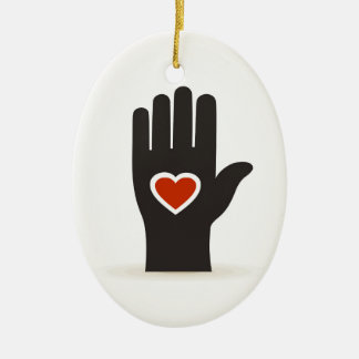 Heart in a hand ceramic oval decoration
