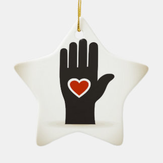 Heart in a hand ceramic star decoration