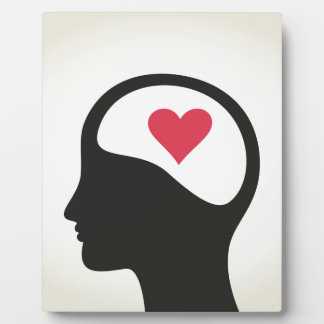 Heart in a head plaque