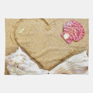 heart in the sand with shells hand towel