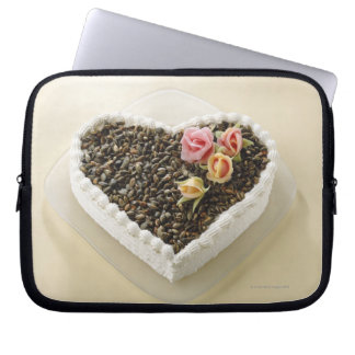 Heart shape wedding cake with flower, close-up laptop computer sleeves